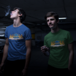 two-young-friends-wearing-different-tshirts-mockup-smoking-in-a-dark-parking-lot-a15455